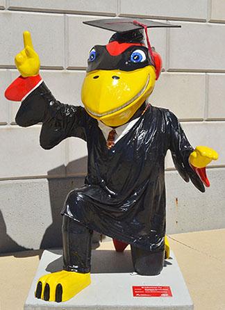Graduation Cy statue